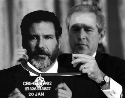 George Bush pins medal on Fugitive